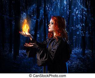 strega, in, il, chiaro di luna, foresta, con, fiamma