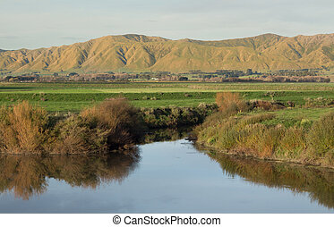 This is one of many streams that flow into the mighty Manautu River. This stream flow water down form the hill behind Shanon, New Zealand.