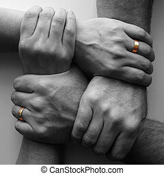 Strength and unity - man and wife holding together for...