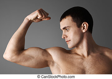 Strength - Close-up of strong muscular man over grey ...