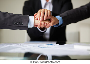 Strength - Image of business partners hands on top of each ...