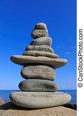 Strength - Stack of sandstone on the background the sky