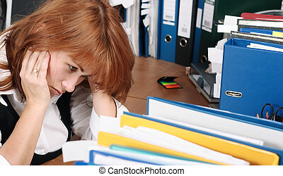 A woman looks tired, stress in office