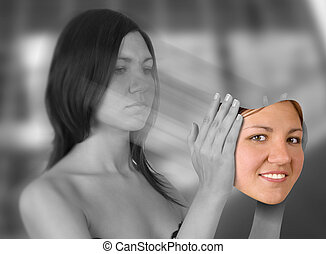 stress concept - Young woman holding smiling face (digital...