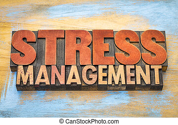 stress management word abstract in letterpress wood type printing blocks