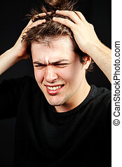 Stress mental pressure concept. Unhappy young man