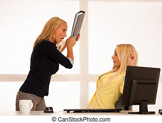 Stress  mobbing - Angry worker wonts to hit a boss with a folder