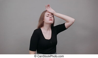 Stress or headache grimacing in pain holds back of neck ...