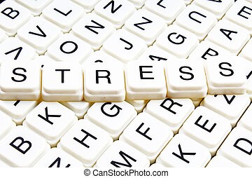 Stress title text word crossword. Alphabet letter blocks game texture background. White alphabetical letters on black background. White educational toy block with words on board table.