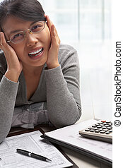 Stress woman with tax form