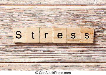 Stress word written on wood block. Stress text on table, concept