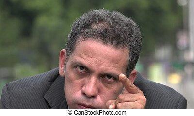 Stressed Adult Hispanic Businessman