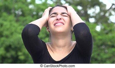 Stressed Anxious Female Hispanic Teenager
