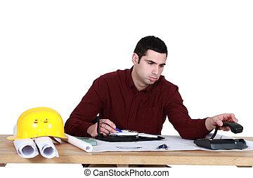Stressed architect sat at desk
