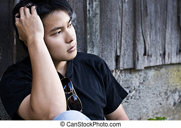 Stressed asian male - A shot of a stressed asian male...