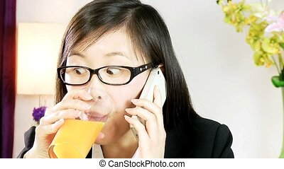 Stressed asian woman on the phone