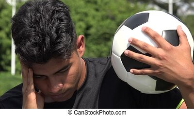 Stressed Athletic Teen Male Soccer Player And Losing
