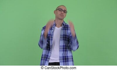 Stressed bald hipster man getting bad news - Studio shot of...