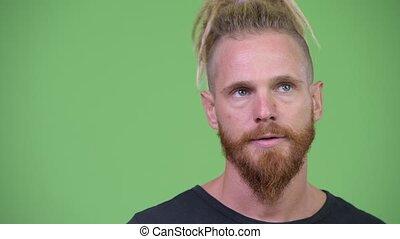Stressed bearded man with dreadlocks looking bored - Studio ...