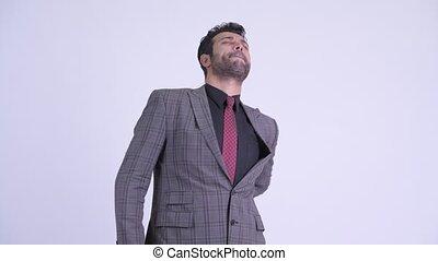 Stressed bearded Persian businessman having back pain