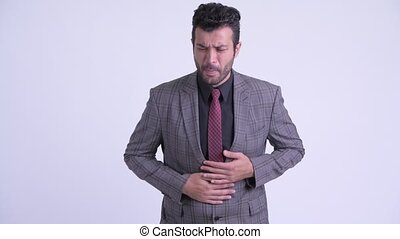 Stressed bearded Persian businessman having stomachache -...