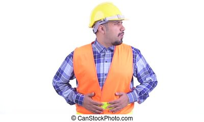 Stressed bearded Persian man construction worker having...