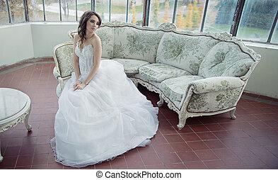 Stressed bride wearing beautiful wedding gown
