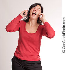 Stressed brunette talking with two phones - Hysterical...