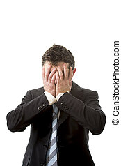 stressed business man covering his face with his hands - ...