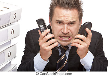 Stressed business man with two telephones is crying in office