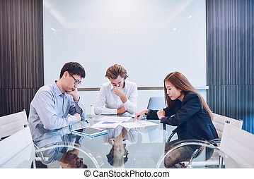 Stressed business team in meeting room, multi-ethnic