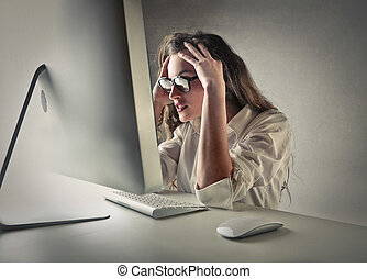 Stressed business woman in front of computer