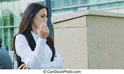 Stressed business woman smoking a cigarette in slow motion