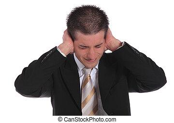Stressed businessman - A handsome businessman pressing his...
