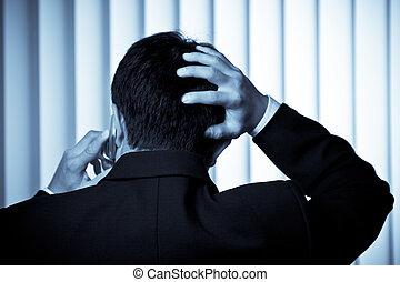Stressed businessman - A shot of a stressed businessman ...