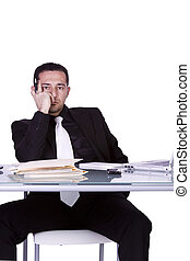 Stressed Businessman at His Desk Working