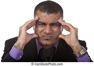 Stressed businessman has bad headache in office