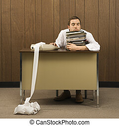 Stressed businessman. - Mid-adult Caucasian male holding...