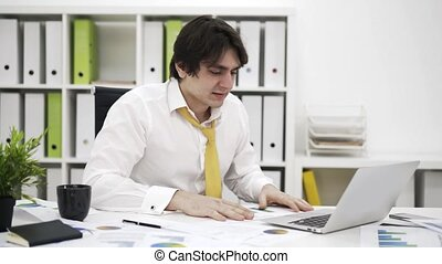 Stressed businessman typing