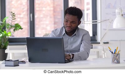 stressed businessman with laptop at office - business,...