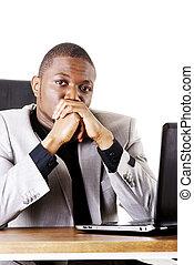 Stressed businessman working on laptop