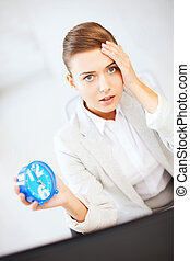 stressed businesswoman holding clock - business and time...