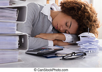 Stressed Businesswoman Sleeping In Office