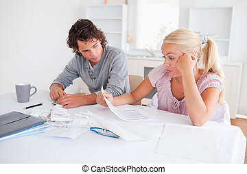 Stressed couple doing accounts