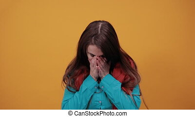 Stressed covered face with hands, crying feels desperate. Fear, shame, domestic violence. Sad emotion, depression, grief or frustration. Human expressions, feelings, reaction attitude Attractive