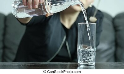 stressed depressed suicidal young woman fill water into glass, slow motion. slow motion