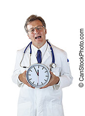 Stressed doctor with clock in front cries because of time pressure