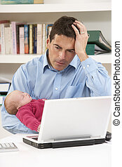 Stressed Father With Newborn Baby Working From Home Using Laptop