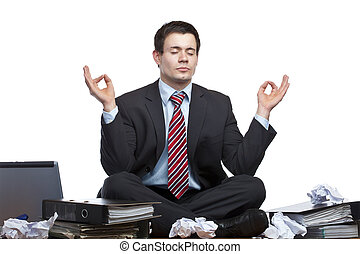 Stressed, frustrated business man meditates in office at desk. Isolated on white background.