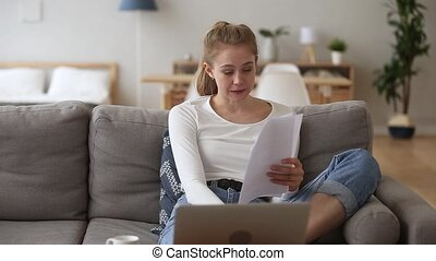 Stressed girl student feeling worried reading bad news in papers